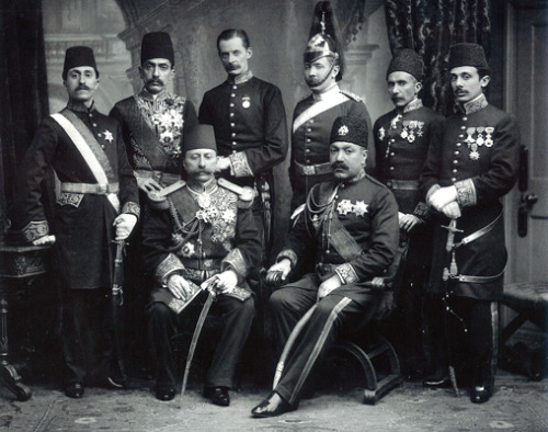 Alla o- Dolleh Prime Minister of Iran (Seated Left) In United Kingdom with Iranian and British Officials
