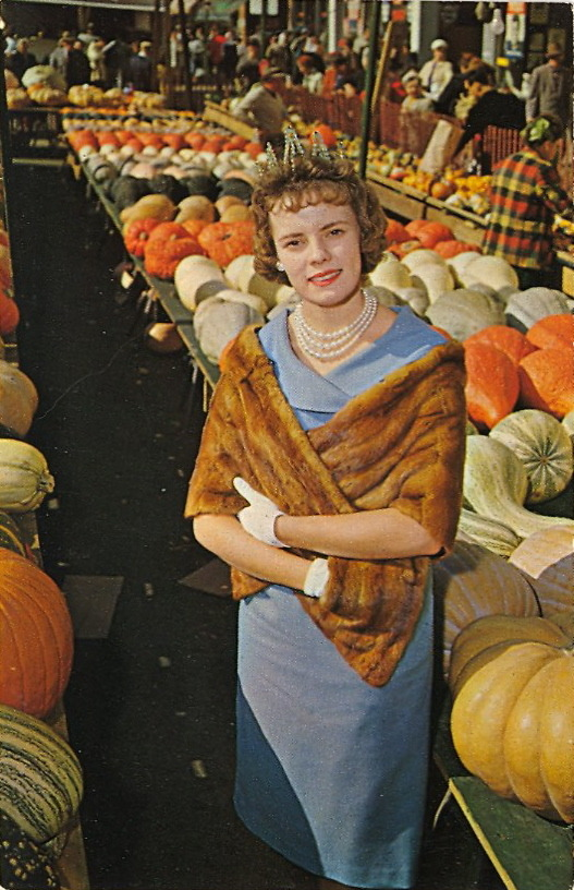 "CAPTION CONTEST — Pumpkin Queen 8/8/12  9:28 AM: Thanks for your captions, everyone! First, here's what's on the verso:  THE CIRCLEVILLE PUMPKIN SHOW at Circleville, Ohio is known as the ""Biggest Free Show On Earth"". Art shows, unusual exhibits and all kinds of food and drink made from pumpkins attract visitors from miles around during the three day festivities held each October.  The winner is Stuft for the caption: ""Isn't she gourd-geous?"" Congratulations, Stuft! To claim your postcard prize, email me at bad.postcards@gmail.com with your choice of postcard from the list below and your mailing address. The RULES1) MAXIMUM of TWENTY (20) WORDS2) One entry per person3) Please enter your caption in the comments of this post4) Submissions will be accepted until Sunday, August 5, 2012 at 8:00 PM EDT The author of my favorite caption will have their choice of one of these original vintage postcards (all previously published on BAD POSTCARDS): 1) WHEN DO WE EAT?2) WELL, SHUT MY MOUTH!3) CLUBHOUSE ESCALATOR4) A VIEW FROM THEIR WINDOW5) MISS SUGARDALE—1958  HAVE FUN and GOOD LUCK!"