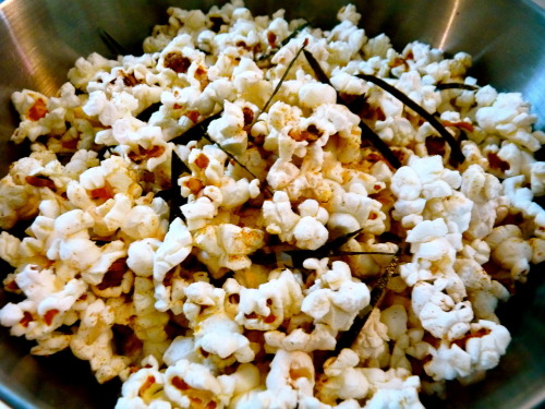 Furikake Popcorn I was reading about Hawaiian Hurricane popcorn, which is a mochi crunch and nori flavored buttery popcorn, a while ago and have really wanted to try it since. I'm going to order the real thing online soon because it sounds sooo good, but for now I'm having my own version of Japanese style popcorn. This is a really satisfying snack for people who like the combination of salty and sweet flavors.  All of the Japanese ingredients are very basic and are easily found at an Asian grocery store. To toast the sheet of nori, turn your stove burner on low heat and pass the nori quickly over the flame a few times on each side until the nori is slightly fragrant.  Serves 2-3  Ingredients: 1 bag plain microwaveable popcorn 1/2 tsp sugar 1 tsp nanami togarashi assorted chili pepper (S&B brand is the most popular and easy to find) 1 packet kombu dashi granules  2 tbsp katsuobushi (dried bonito flakes) 1 sheet toasted nori, cut into small strips Method:  Toss together the sugar, nanami togarashi, kombu dashi granules and katsuobushi with the freshly popped popcorn in a large mixing bowl. Top with the toasted nori and serve.