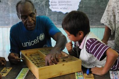 unicef:  UNICEF Goodwill Ambassador Danny Glover and a boy use learning tiles to form words in Shipibo, the local indigenous language, during his visit to the primary school in the indigenous Shipibo-Conibo community of Nuevo Saposoa in the Peruvian Amazon. The school provides bilingual inter-cultural education for indigenous children. All classes are taught in the Shipibo language. In Ucayali Region, the Ministry of Education and UNICEF are providing books written in the local language and supporting teacher-training in the indigenous language and culture. © UNICEF/Susan Markisz http://www.unicef.org  this.