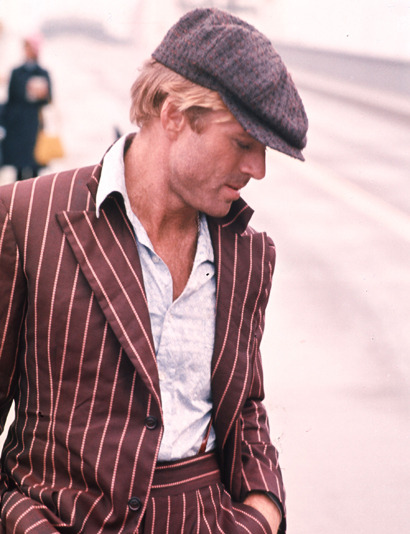 clubmonaco:  Robert Redford mixing wide pinstripes with a plaid hat.