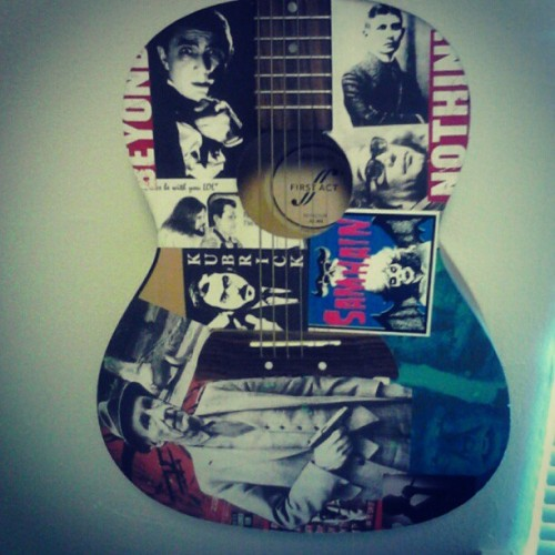 Quick shot of my art project guitar #guitar #stickers #colloge #kafka #kubrick #burroughs #lugosi #kurosawa (Taken with Instagram)