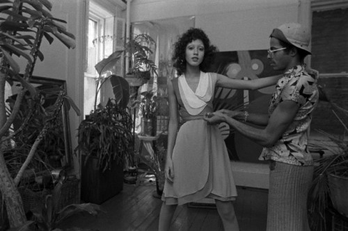 "Pat Cleveland being fitted by designer Stephen Burrows in his East Village studio in April 1971. Burrows was a newly rising star in fashion at this time, especially after the opening of his boutique, ""Stephen Burrows World"" in Henri Bendel  in New York. The daughter of a jazz musician and the celebrated painter, Lady Bird Cleveland, Pat had already traveled with Ebony Fashion Fair and was in the beginning stages of her legendary runway career (the groundbreaking fashion show featuring Black models in Versailles show was two years away). Photo: Pierre Scherman/Conde Nast Archives/Corbis."
