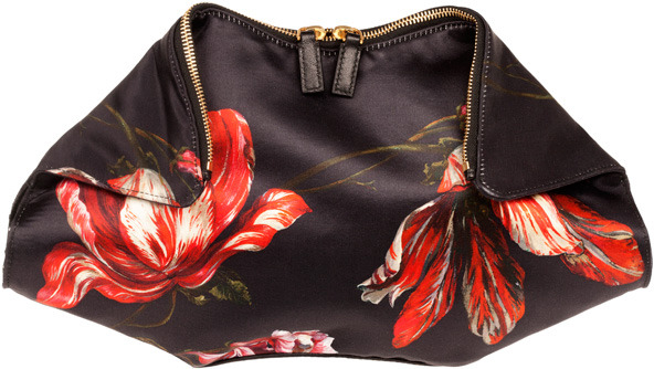 Alexander McQueen's De Manta clutch inspired by the shape of a manta ray and created in a beautiful tulip covered satin-silk with leather trim. For only $525 get your hands on one now and you will be on top of the carry all trend for fall. -JK
