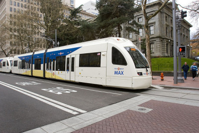 "massurban:  ""Can Light Rail Carry a City's Transit System? ERIC JAFFE. August 1, 2012 We often think of light rail as a single component of a larger transit system, but if it's done right it can just as soon serve as the foundation. Since 1981 a dozen American cities have built light rail lines atop bus-only systems. In five of them — Dallas, Portland, Sacramento, Salt Lake City, and San Diego — light rail now accounts for at least 30 percent of all transit ridership in the metropolitan area, even as it covers less than that much service space in the region. Transit researchers Gregory Thompson and Jeffrey Brown of Florida State, known for their espousal of multi-destination transit systems, recently took a closer look at these light rail systems to determine what characteristics define the best of the best. In a recent issue [PDF] of the Journal of Public Transportation, Thompson and Brown identify two of these ""backbone"" systems in particular — Portland and San Diego — as far more efficient than the others. Thompson and Brown settled on three key factors in the success of these systems. First, a great light rail system anchors a transit network that's dispersed throughout a metro area. Second, it acts as an express regional alternative to the local bus network. And third, it promotes transfers between the bus and rail systems. The researchers believe these traits can serve as guides for future light rail planners ""by setting forth attributes that these services need to possess in order to attract substantial ridership."" In good Olympic spirit, the researchers then judged all five of the above ""backbone"" systems and gave them scores of up to five points on each success marker, for a possible total of 15 points. Here's how the light rail systems placed, from highest- to lowest-scoring. (Caveat: the data were collected circa 2007, which made the evaluations especially unfavorable to Salt Lake City's popular TRAX system, so we've omitted that here.)"" Via: The Atlantic Cities Photo: Flickr user TriMet via Creative Commons"