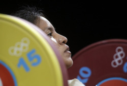 Silvana Saldarriaga of Peru competes during the women's 63-kg weightlifting competition at the 2012 Summer Olympic