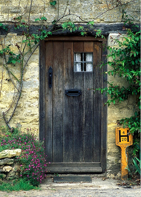 A cottage door in the town of Bibury located in the English Cotswolds region. By Tony Triolo