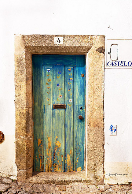 Old painted door in a ancient house in the medieval town of Marvão, Alentejo, Portugal. By Sergio Duarte