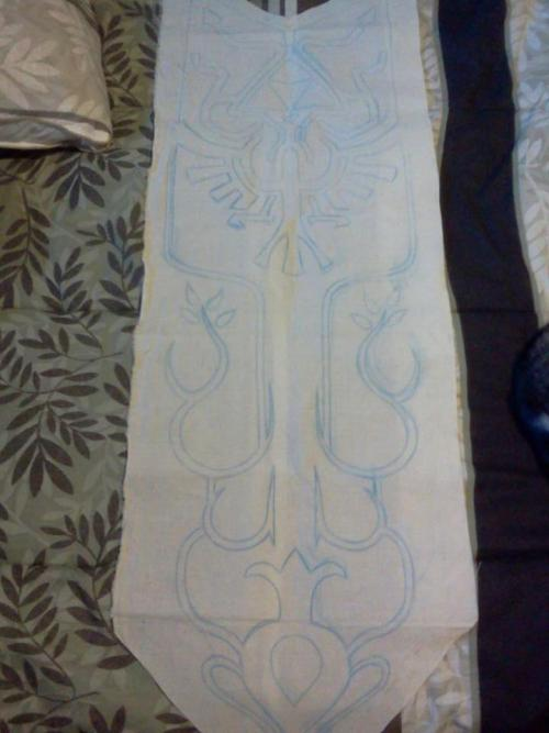 The beginnings of my Zelda tabard. Next up: Sewing on a backing fabric, adding the black stitching and tossing it back in the wash to get rid of any of the blue chalk pencil. Then painting begins!
