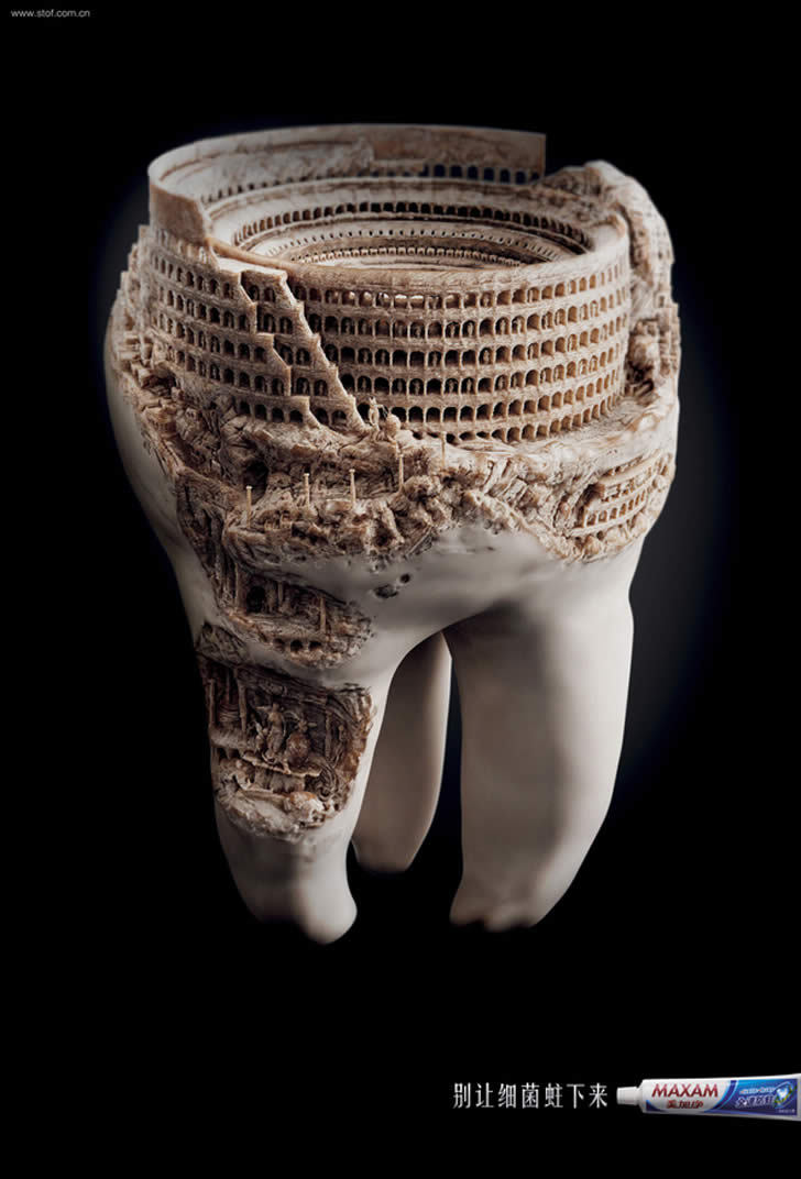 "axials:  This image is part of a print advertising campaign for Maxam's toothpaste. The idea is to not let germs settle down on your teeth, or else you will end up with a ""Colosseum"" cavity. The design was envisioned by agency JWT Shanghai."