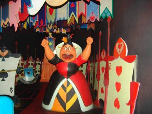 On the original Alice in wonderland ride there wasn't a scene that featured the Queen of Hearts. That section of today's ride used to house the Mad Tea Party and the Grande Finale, which consisted of flashing lights, banging doors, and crazy signs. After that the cars would slowly drift down back to the station.