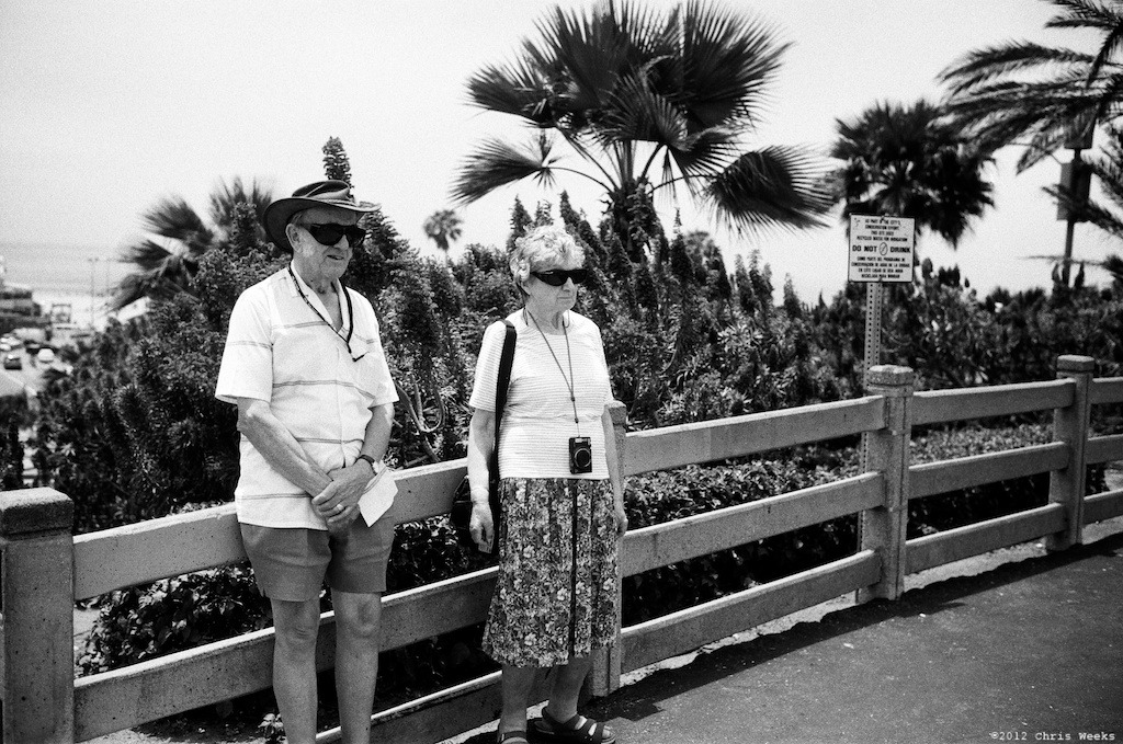 Santa Monica, Calif.:  July, 2012.   Tourists.  Leica MP.  35 'lux.  Lab scan »> Aperture.  (Fuji Neopan 400 with ND)