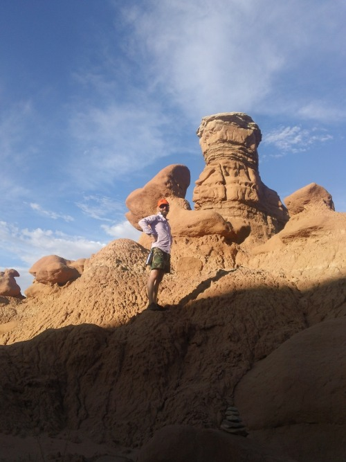 dressed funny and racing against sunset at goblin valley state park, near green river, ut