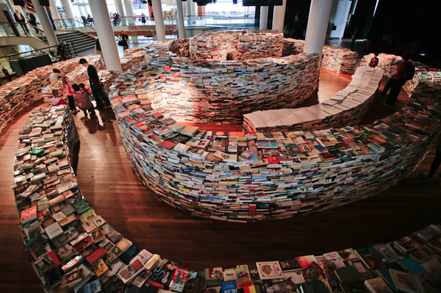 "bookmania:  Meanwhile, in London. The promenade of art projects doesn't stop in 2012 London's Olympic arena, as an art project entitled aMAZEme continues today highlighting a book-maze masterpiece created by Brazilian artists Marcos Saboya and Gualter Pupo. The ""stacked"" and ""twisting"" 250,000-piece book labyrinth is based on writer's Jorge Luis Borges' fingerprint. The huge art installation will be on display in the Clore Ballroom until August 25th. (via thisiscolossal)"