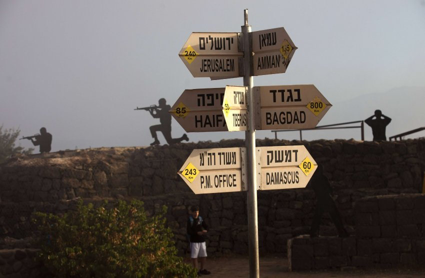 A road sign in the Golan Heights shows distances to various cites in the Middle East. Isael has warned that it could take preemptive military action should weapons of mass destruction fall into the hands of radical groups like Hezbollah.  Syrian Disintegration