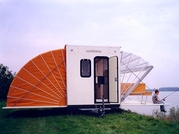 "RED AWN ""De Markies"" (The Awning) was an entry in the ""Temporary Living"" competition 1985 and was conceived as a mobile home. On the road, it measures 2.00 m by 4.50 m, and once it has arrived at its destination its floorspace can be increased threefold in a matter of seconds."" - Markies via BS Report via Markies"