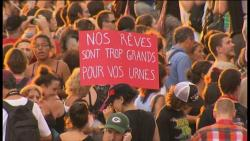 "thepeoplesrecord:  Quebec protesters enter 100th day of demonstrations against austerityAugust 1, 2012 As Quebec's political ranks gear up for a late summer election campaign, student protesters and their supporters took to the streets with renewed fervour. For the 100th night in a row, protesters marched through Montreal streets, with many banging on pots and pans, reminiscent of evening protests that spread across the city in the spring. The number of protesters who took to the streets Wednesday was higher than it has been in recent weeks. Some carried large red banners with anti-Jean Charest slogans, and electoral messages like ""our dreams are too big for your polls."" The protest came as Premier Charest triggered an election, with voters heading to the polls on Sept. 4. The vote call comes on the heels of Quebec's raucous student crisis over tuition increases, that gripped the province last winter and spring. Many of the hundreds of people who joined the street march donned masks to mock a controversial city bylaw forbidding face coverings at public protests. Protesters started their march in the Villeray district, north of the Jean-Talon Market, and slowly made their way south via St-Denis Street. Several media outlets reported one protester was injured after a car hit him at the corner of Saint-Denis Street and Laurier Avenue. The Villeray protesters joined another group in the Émilie-Gamelin Park, near UQÀM. Police supervised the crowd and declared the protest illegal just after 9 p.m., but told people they could continue to march if they kept the peace. Wednesday night was the 100th night in a row that students and their supporters took to the streets. Thousands of students started to boycott classes in February to protest tuition increases. The boycott evolved into daily protests by spring. After months of negotiations, student leaders rejected the government's final, watered-down tuition increase offer in May. The student-fuelled protests escalated, prompting the Liberal government to pass Bill 78, a temporary law that restricts the size and location of some protests, if authorities aren't alerted ahead of time. The legislation also suspended the winter semester for college and university students, effectively allowing them to retake missed classes later this year rather than losing a term. Protesters have been subject to the rules laid out in Bill 78 since its adoption, but it's not clear whether any of its rules have been formally implemented by police. The passage of the bill fuelled public anger towards the government. What was initially a student-led protest movement spread to include civil rights groups, families, and seniors. An adjunct casserole protest movement mushroomed in May, with average people taking to the streets every night to bang on pots and pans in cities across Quebec. The protests petered out over the summer, just as Montreal's festival circuit kicked into high gear. Source The poster reads ""Our dreams are too big for your polls."""