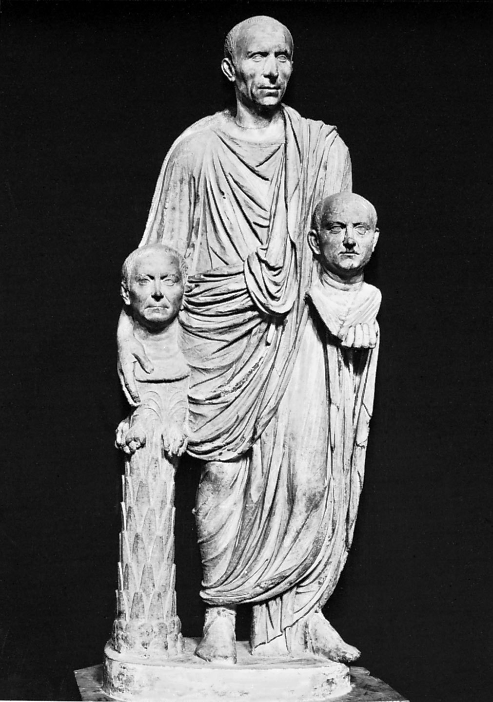 The Ancient Roman sculpture Patrician Carrying Busts A Roman man holding busts of his ancestors. Late first century BC, made of marble and is life sized. The great importance that Romans attached to family and lineage is exemplified here in this austere sculpture, and also is an example of the development of highly realistic Roman portraiture during the republican era. This staute also shows the Roman belief in respect for authority. The high level of realism of the sculpture may have been assisted by the use death masks. Shortly after someones death a wax mask was modeled on the face of the dead and was then transfered to stone. Masks of the ancestors of the dead were carried and worn in the funeral processions, and portrait busts and images of ancestors were generally displayed in homes to show the importance of family and ancestors.