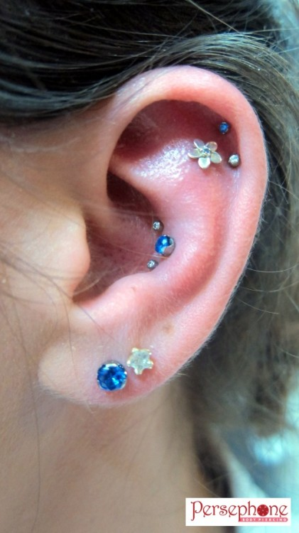 I've posted photos of this client several times before, but we've just updated some jewellery! Jewellery by Anatometal in everything except that second earlobe piercing!