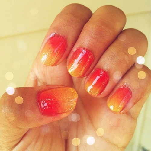 "Sunset ombre nails! Polishes used: L'Oreal ""Tweet Me"", Sally Hansen Xtreme Wear ""Sun Kissed"", Essie ""Ole Caliente"", Sally Hansen Double Duty Base & Top Coat How-to: Watch this video by AndreasChoice here!"