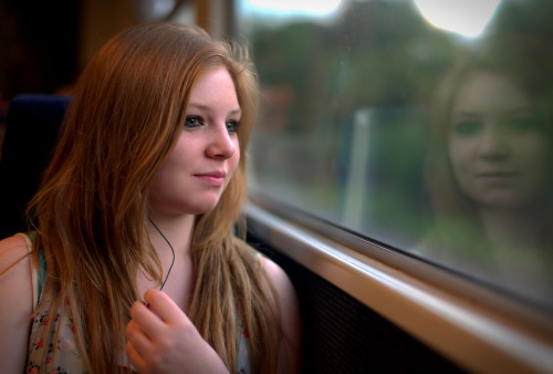 I photographed this girl on the train with a Leica M9 set to shoot only raw. I then inserted the SD card via the camera connection kit into my iPad and converted the image to JPEG.  This isn't a big deal with most raw files as the iPad can deal with them fine. Not so with Leica files.  There is still nothing in the app store that does this smoothly. Believe me, I have looked. The app I used is not out yet and I have not yet had clearance to blog about it.  All I will say is that you may already have a version of this app as it has been a photo editors choice for a long time.  There are still a few bugs to iron out, but on the whole I am really excited that at last Leica users will easily be able to edit and upload their awkward RAW files without lugging their laptop around.  I'm looking forward to doing a more indepth review on http://Documentally.com