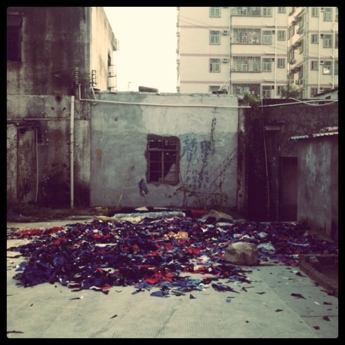 helloagainchina:  A sweatshop in the Wutong mountain. Rags are scattered outside. Looks like they make school uniforms? (Taken with Instagram)  A discovery on our bike ride through Daping village.