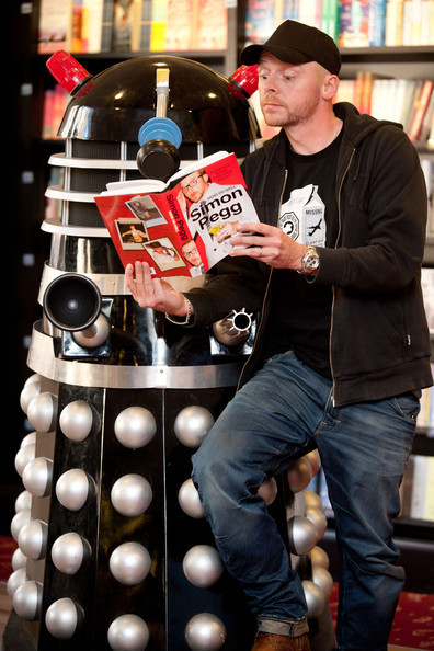 Simon Pegg and friend read.