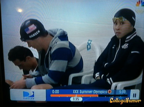 Olympic Swimmer Has Hands in Pants Caught on camera.