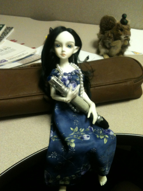 Krina being a Time Lady (Time Rusalka? xD) on my desk at work.  Yes, there's a toy squirrel with a toy duck on its head in the background. Long story.