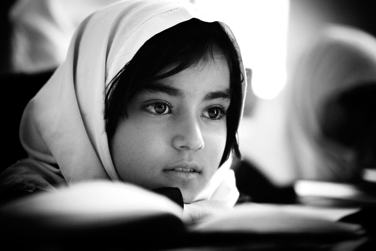 From Afghanistan, July 2012: Faces of Hope, one of 28 photos. A young girl pictured in a classroom in Herat, Afghanistan, in June of 2010. If there ever was a face of hope for the future, the new educated generation of young girls. They comprehend the chance they have been given more than we can ever imagine, they know it was a chance denied their mother's. (© Martin Middlebrook)