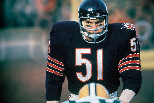 Bears linebacker Dick Butkus watches the offense during a 1969 game against the Packers. The Chicago legend, who made the Pro Bowl eight times in his nine-year career, averaged 120 tackles and 58 assists a season. (Neil Leifer/SI) GALLERY: Historic Photos of the NFL Draft