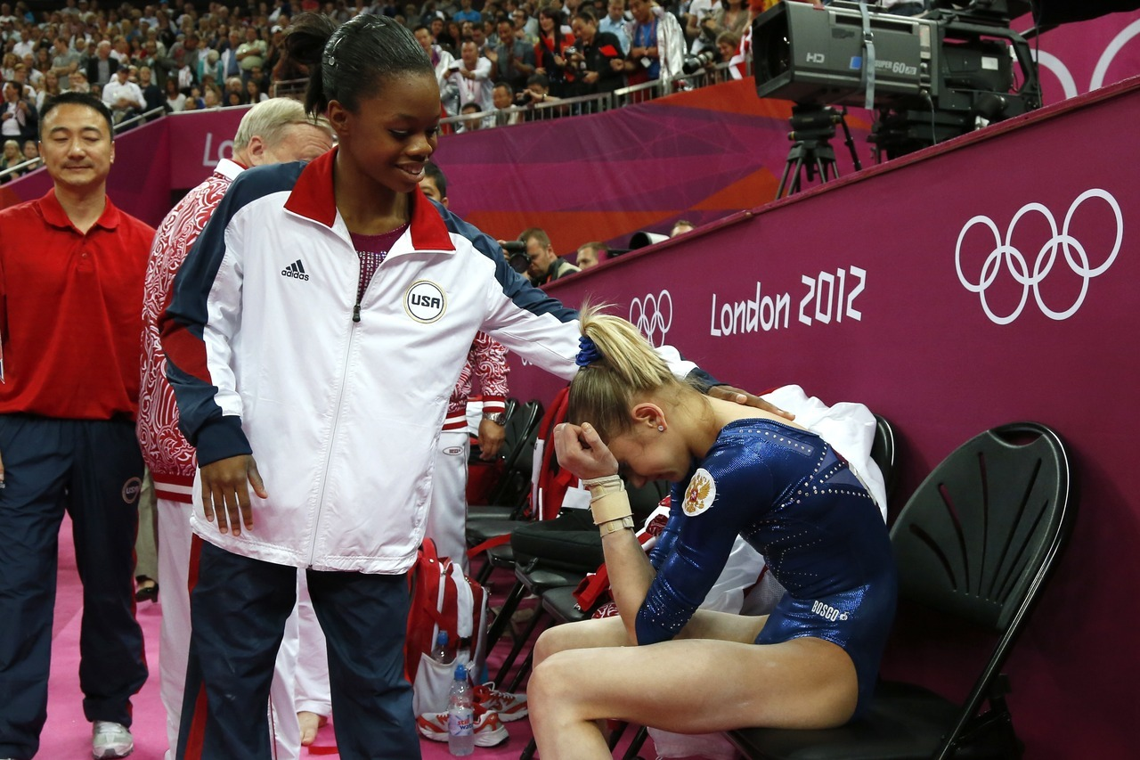 nationalpostsports:  U.S. gymnast Gabrielle Douglas comforts a crying second-placed Russia's gymnast Victoria Komova after she won the artistic gymnastics women's individual all-around final. Make it a pair of golds for Douglas, who added another gold to the one she won with the U.S. team two nights ago.