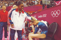 kyssthis16:   Gabby Douglas comforts a crying Viktoria Komova after her win of over three tenths to knock Komova down to silver.  #'you'll pull through'