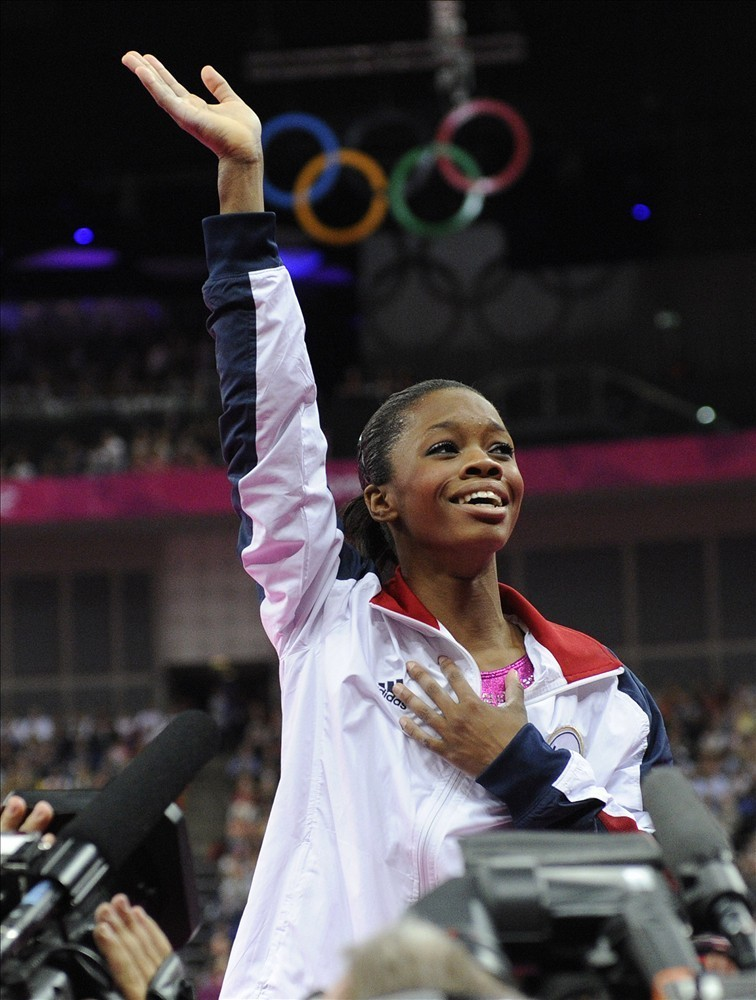 Gabby Douglas reacts to winning Gold in the women's gymnastics all around. She became the first African-American to win the all around and the third female gymnast in a row to win the medal for the United States. Determined and poised while making history…She has a bright future ahead of her! Congratulations Gabby!