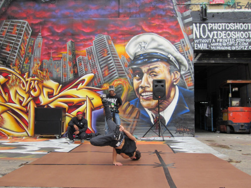 B-boy breaking in front of a Fire Marshall Bill mural at 5Pointz in Long Island City in Queens, New York (by Karin du Maire)