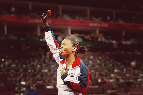 annaetc:  Gabrielle Douglas captures gold in the women's gymnastics all-around competition. She becomes the first African-American woman to win this title and the first American woman to capture gold in both individual and team events in the same Olympics. Amazing woman is amazing.