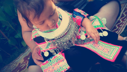 My mixed cousin in Hmong clothes~