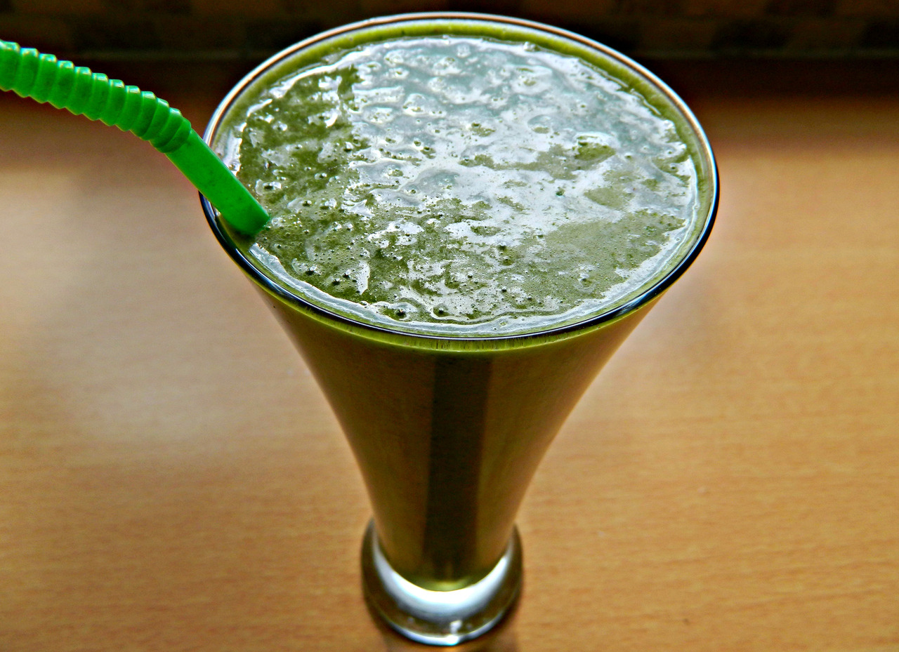 Green smoothie - spinach, banana, dates, ground flaxseed, chia seeds, peanut butter, almond milk and ice cubes. And a straw. :3