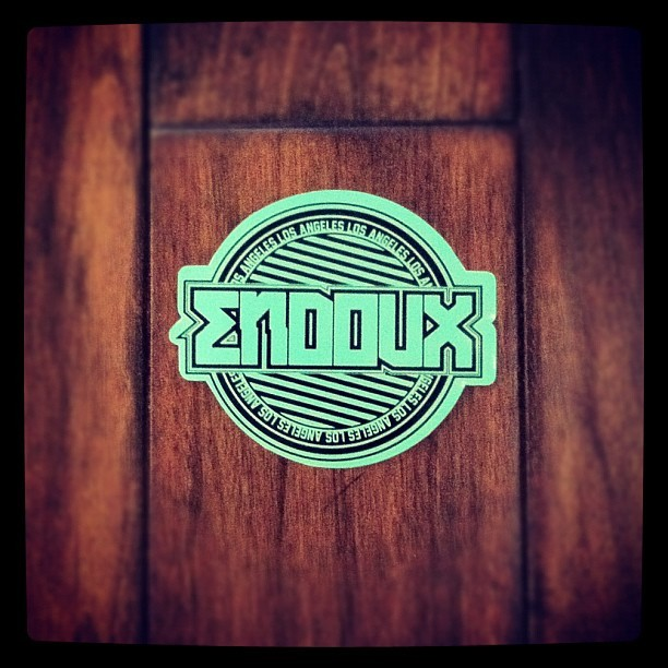 One of my #new @endovx #stickers that I helped make! :3 #endovx #losangeles #la #mint #logo #design #screenprinting #decal #contour #cut #ink #style #brand #cute #:3 #black #wood #graphic #premium #sick #instagood #instalove #weheartit #sticker  (Taken with Instagram)