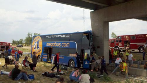 State officials have confirmed that the Megabus, which crashed into a concrete pillar off of I-55, lost control as the result of a flat tire. Firefighters have been forced to use four ladders to try and free passengers trapped in the top of the bus, and more than 30 ambulances have reportedly arrived on-scene. 15 patients have been sent to surrounding hospitals, but no word yet on the severity of their injuries. A live, but audio-free, stream of the continuing events is available here. (Photo via Jennifer Feldman) More on the story here