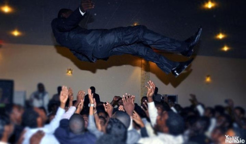 Throwing the arees (groom) up in the air on his wedding day# only in Sudan!