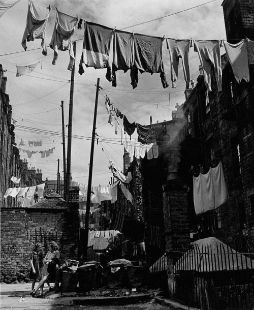 sagaston:  kyethn:  sagaston:  kyethn:  sinuses:  Dundee, Scotland 1944. Photographed Wolfgang Suschitzky.  Oh, cool! You don't see many pictures of Dundee popping up on tumblr, never mind awesome historical ones. This looks like it might be near where I live.  Woah. I had no idea. I just reblogged it because it looked cool and I might steal it for Clockworks inspiration one day.  Man, I should seriously go out and snap photo references for you at some point. I'm basically surrounded by industrial era buildings. Dundee's a pretty interesting looking place if, you know, you can get over how grey everything is.  I'll trade you photos of old St. Louis neighborhoods. Our run down steampunk cities can look like each other's home towns!  Well, I definitely can't pass on an awesome deal like that. I'll see about digging out the ol' camera! Here's some bonus context: the street I live on is still cobblestone paved. i mean who even needs tarmac