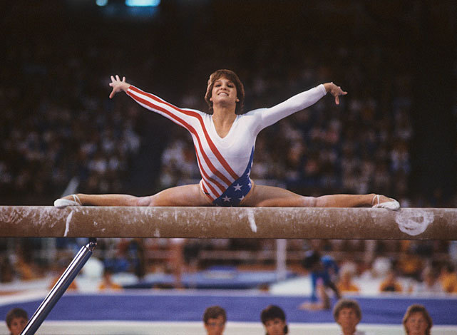 Mary Lou Retton competes on the balance beam during the 1984 Summer Olympics at Pauley Pavilion in Los Angeles. Retton would win five medals at the 1984 Games - one gold (All-Around), two silver (Team, Vault) and two bronze (Uneven bars, Floor). Much like Retton in 1984, Gabby Douglas and the entire U.S. Women's Gymnastics team has become one of the most popular American teams competing in the summer Olympics.  (Neil Leifer/SI) GALLERY: U.S. Olympians Then and Now | Best Summer Olympics CoversGALLERY: Classic Photos of Gabby Douglas | U.S. Wins Gymnastics Gold