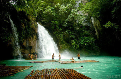 Kawasan Falls, The Philippines, east of heaven. Kawasan Falls is a three-tiered cascade of crystal clear waterfalls. It's the highlight of Badian. The waterfalls has been awarded many times as the cleanest inland body of water in the Philippines. The water coming from the falls is clean and crystal clear.