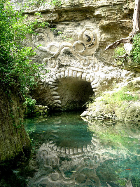 visitheworld:  Mayan entrance in the caves of Xcaret, Riviera Maya, Mexico (by raulmacias).