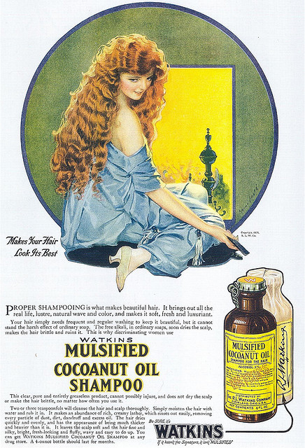 "Will Grefé, Watkins Mulsified Shampoo, 1920 on Flickr.   Scanned from Taschen's ""All-American Ads of the 20s"". Click image for 1232 x 1809 size. ""Makes your hair look its best Proper shampooing is what makes beautiful hair. It brings out all the real life, lustre, natural wave and color, and makes it soft, fresh and luxuriant. Your hair simply needs frequent and regular washing to keep it beautiful, but it cannot stand the harsh effect or ordinary soap. The fre alkali, in ordinary soaps, soon dries the scalp, makes the hair brittle and ruins it. This is why discriminating women use Watkins Mulsified Cocoanut Oil Shampoo This clear, pure and entirely greaseless product, cannot possibly injure, and does not dry the scalp or make the hair brittle, no matter how often you use it. Two or three teaspoonfuls will cleanse the hair and scalp thoroughly. Simply moisten the hair with water and rub it in. It makes an abundance of rich, creamy lather, which rinses out easily, removing every particle of dust, dirt, dandruff and excess oil. The hair dries quickly and evenly, and has the appearance of being much thicker and heavier than it is. It leaves the scalp soft and the hair fine and silky, bright, fresh-looking and fluffy, wavy and easy to do up. You can get Watkins Mulsified Cocoanut Oil Shampoo at any drug store. A 4-ounce bottle should last for months. Be sure it's Watkins If it hasn't the Signature, it isn't 'mulsified'"""