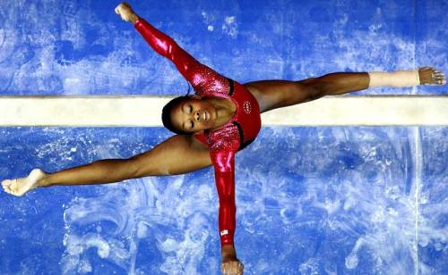 lostbetweenthepages:  (via Black Gymnast Gabby Douglas Grabs Top Spot on U.S. Gymnastics Team - COLORLINES) YEAH! Go Gabby Go!!! :) So happy for her! and the US Women's Gymnastics team!