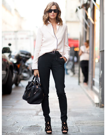"This look is simple to recreate with a ""flowy"" blouse, and skinny denims, with hot bootcut heels! Don't forget the accessories, mix it up with a clutch, long shoulder strap purse, or the oversize arm bag."