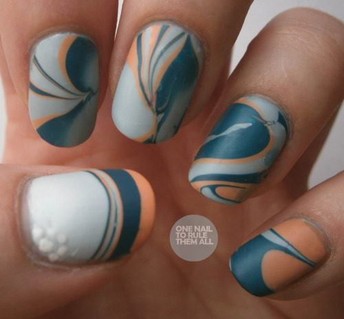 Day 20: Watermarble. Sorry guys! I know today is meant to be galaxies and is also Day 19, but I'm afraid that will have to come tomorrow. Also, I hate watermarbling. Boo. I can't believe this even worked, this is the best I've ever made them look and they still look awful :( Read more on my blog.
