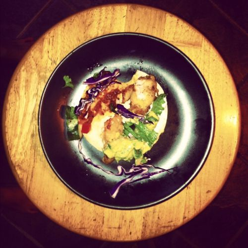 Taco de pescado Baja Califas style con bacalao, Crema rustica, purple cabbage and of course Gustavo's Chipotle Salsa